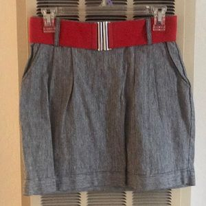 Black/grey skirt with pockets with a red belt